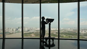 Turist looking through binoculars on observation deck in tower Ho Chi Minh city 2. Observation deck tower in Ho Chi Minh city with tourists stock video footage