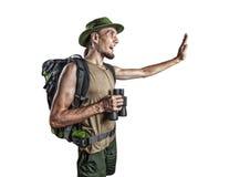 Turist med binokulärt som isoleras på vit Arkivfoton