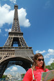 A turist near Tour Eiffel. A turist near  Tour Eiffel in Paris with blue sky Royalty Free Stock Image