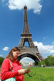 A turist near Tour Eiffel. A turist near  Tour Eiffel in Paris with blue sky Royalty Free Stock Photos