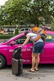 Turist och taxi Royaltyfria Foton