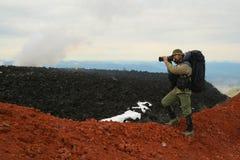 Turist-photographer. Kamchatka. Kamchatka.Turist-photographer from the Avachinsky volcano crater Stock Image