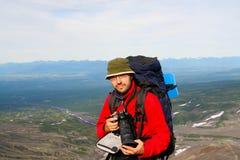 Turist-photographer. Kamchatka. Kamchatka.Turist-photographer on the background of volcanos Royalty Free Stock Image