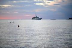 Turist ship on beautiful sky background. Tourist ship sails on the sea, on beautiful sky background Royalty Free Stock Image