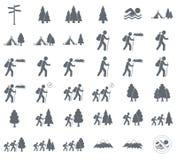 Turist- tältsymbol och skog arkivbild