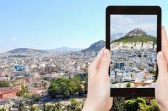 Turist- tagande foto av Atencityscape Fotografering för Bildbyråer