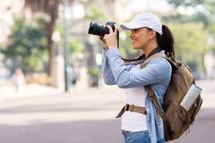 Turista che cattura le maschere Immagini Stock