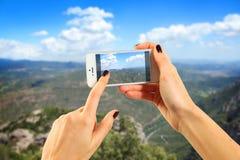 Turista che cattura una foto Fotografie Stock