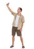 Turista feliz que hace las fotos de se Imagen de archivo libre de regalías