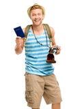 Turista feliz que mantem a câmera retro do passaporte isolada no branco Fotografia de Stock Royalty Free