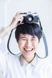 Turista femenino asiático joven que tiene la diversión  Portra de la forma de vida Imagen de archivo