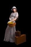 Turista femminile con la valigia dell'annata Fotografia Stock