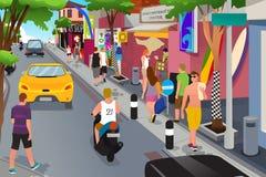 Turista que anda em torno das lojas de lembrança Fotos de Stock Royalty Free