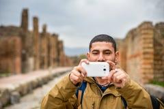 Turista que toma uma foto Imagem de Stock Royalty Free