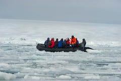 Turistas atrapado en el hielo antartico. A zodiac boat with tourists is trapped in the ice of the Weddell Sea, Antarctic Peninsula Stock Photos