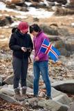 Turistas del invierno de Islandia Imagen de archivo libre de regalías