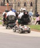 Turistas eléctricos de la silla de rueda imagen de archivo libre de regalías