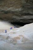 Turistas en abrigos esquimales azules Fotografía de archivo libre de regalías