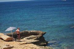 Turistas en la playa de Isulidda Imágenes de archivo libres de regalías