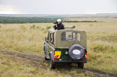 Turistas en safari Foto de archivo