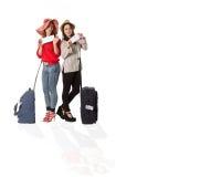Turistas femeninos jovenes y el aeropuerto Fotografía de archivo libre de regalías