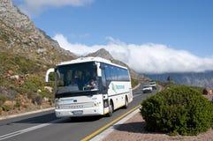 Turisten turnerar bussträdgårdrutten Sydafrika Arkivfoto