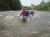 Turister i kanoter Royaltyfria Bilder