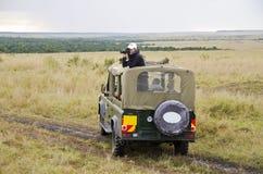 Turister på safari Arkivfoto