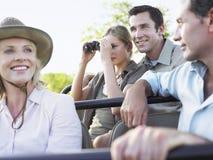 Turister på Safari In Jeep fotografering för bildbyråer