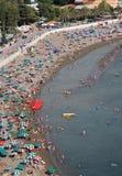Turisti alla spiaggia Fotografie Stock