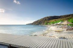 Turisti che godono della spiaggia di sabbia di bianco di Oporto Mari Immagini Stock