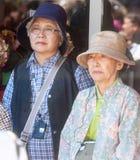 Turisti giapponesi sul festival di folclore in Bulgaria Immagine Stock Libera da Diritti