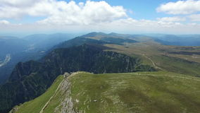 Turists enjoying the view from Caraiman Peak, Romania, aerial view. Hd video stock footage