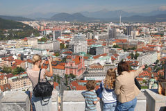 Turists looking down on main city of Slovenia - Ljubljana Stock Photography