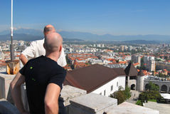 Turists looking down on main city of Slovenia - Ljubljana Royalty Free Stock Images
