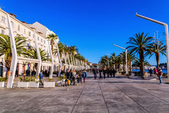 Turists and residents walking along the sea side in historical part of Split in Croatia Stock Image