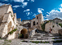 Turists visit ancient town of Matera Sassi di Matera stock photo