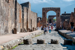Turists visit remains of Pompeii Italy. Pompeii was destroyed an Royalty Free Stock Photo