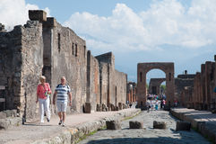 Turists visit remains of Pompeii Italy. Pompeii was destroyed an Royalty Free Stock Images
