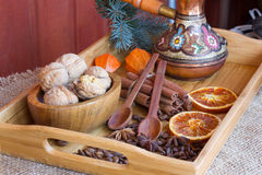 Turk for brewing coffee, black walnuts , cinnamon sticks,candied orange and anise spice on a wooden tray Royalty Free Stock Images