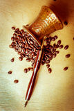 Turk and coffee beans Royalty Free Stock Image