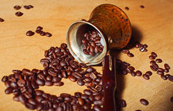 Turk and coffee beans Royalty Free Stock Images