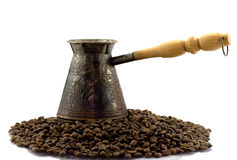 Turk on coffee beens Royalty Free Stock Image