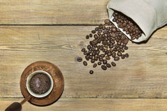 Turk with coffee and sack of coffee beans Stock Photography