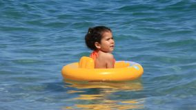 Turk little girl in the sea. TURKEY, ANTALYA, JUNE 21: 2011: Summer holiday at the seaside. Recreation and water entertainment in Antalya city, Turkey, June 21 stock footage
