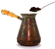 Turk and spoon with ground cofee Stock Photos