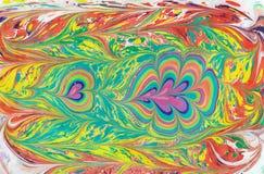 TurkEbru konst Vatten dras, då överförs till papperet Arkivfoto