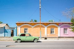 Pastel color of houses and a old car royalty free stock images