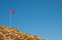Turkey. Flag on the amphitheatre in Side royalty free stock photography