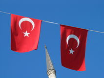Turkey. Turkish flags and a minaret in Istanbul Royalty Free Stock Images